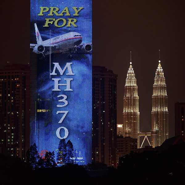 An electronic billboard displays a message about the missing Malaysian Airlines flight MH370