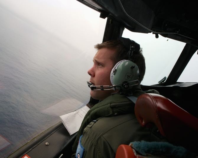 Co-Pilot, Flying Officer Marc Smith, turns his Royal Australian Air Force (RAAF) AP-3C Orion aircraft at low level in bad weather whilst searching for the missing Malaysian Airlines Flight MH370 over the southern Indian Ocean