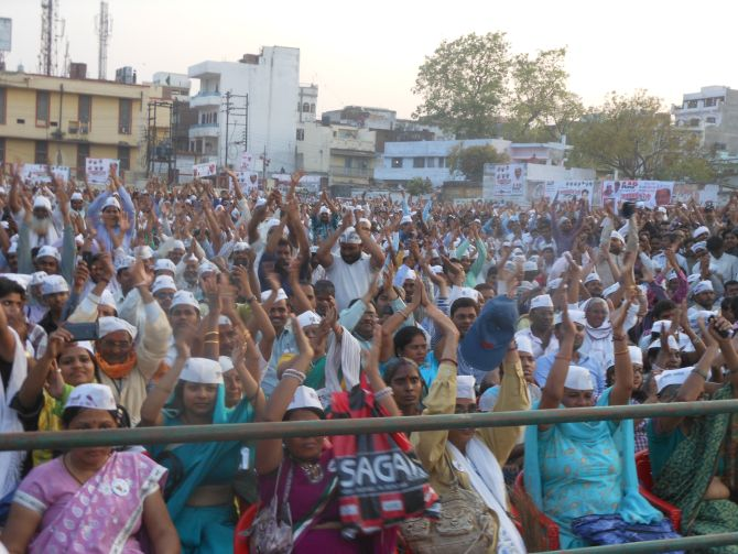 Supporters cheer for Arvind Kejriwal during AAP's rally in Varanasi on Tuesday