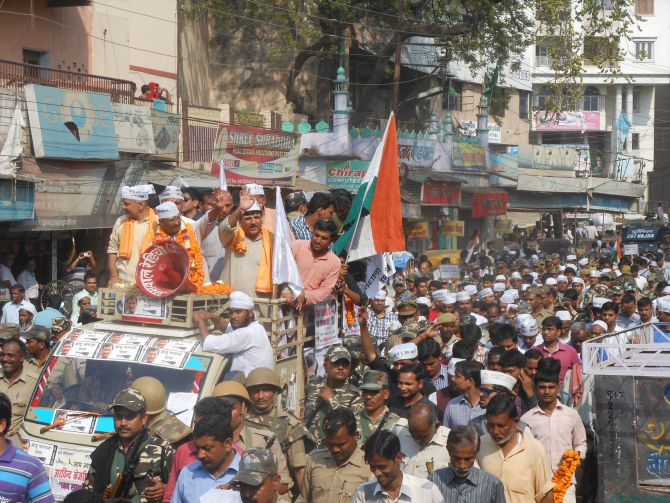Arvind Kejriwal and other AAP leaders attend a road show in Varanasi earlier on Tuesday