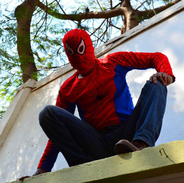South Mumbai independent candidate Gaurav Sharma, scales a sky rise in the city in 'Spiderman' costumes to campaign, on Tuesday