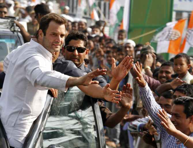 Rahul Gandhi greets supporters during a road show in Gujarat