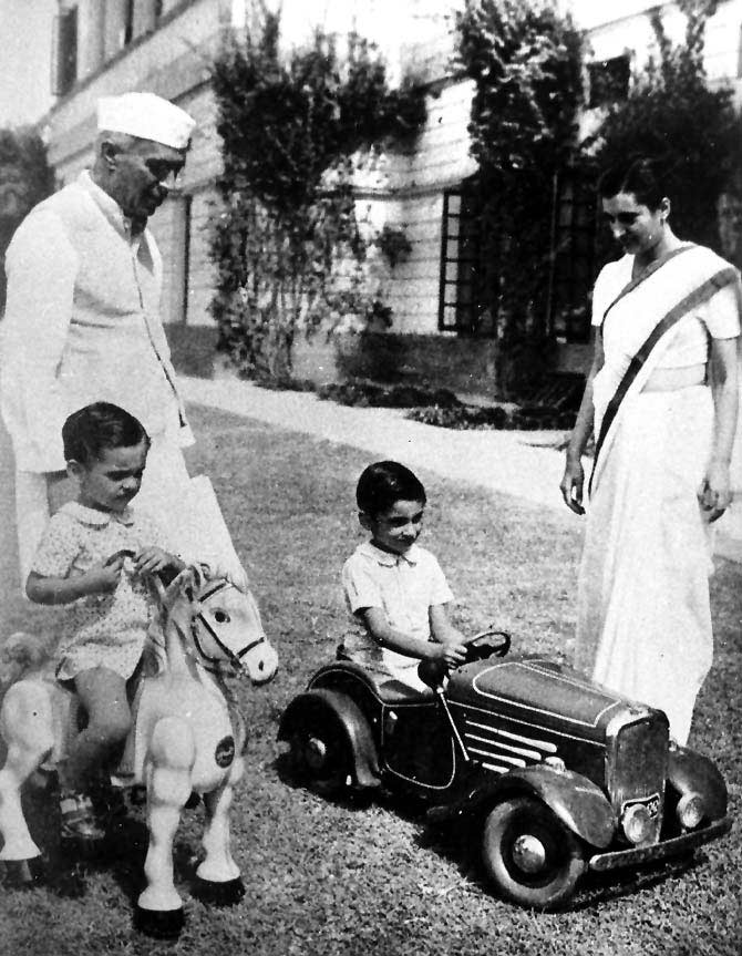 Nehru with daughter Indira Gandhi and grandsons, Rajiv and Sanjay.