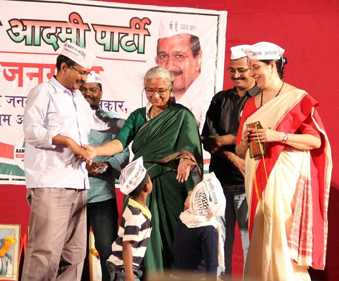 Medha Patkar at a rally in Kannamwar Nagar in suburban Vikhroli. Also seen are Arvind Kejriwal and, extreme right, Meera Sanyal, the AAP candidate from Mumbai South.