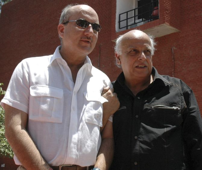Actor Anupam Kher, left, whose wife Kirron Kher is the BJP candidate from Chandigarh, with his mentor Mahesh Bhatt.