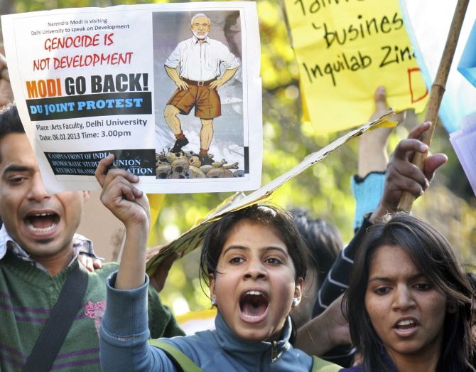 Demonstrators at a protest against Narendra Modi outside a New Delhi college.