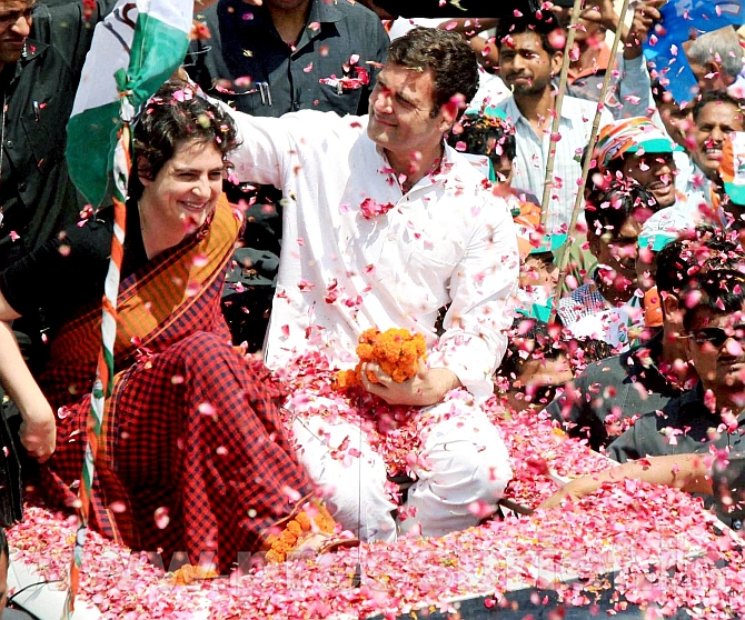 Rahul Gandhi with his sister Priyanka during a road show in Amethi.