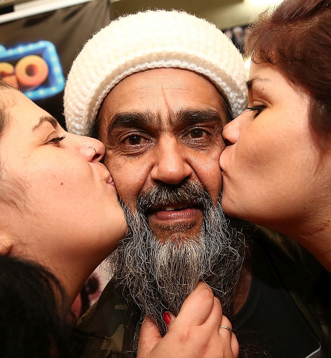 Osama bin Laden lookalike Ceara Francisco Helder Braga Fernandes poses with girls in his 'Bar do Bin Laden'