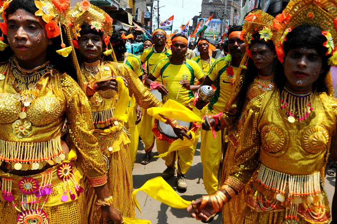Tribal dancers add colour to Moon Moon Sen's campaign trail.