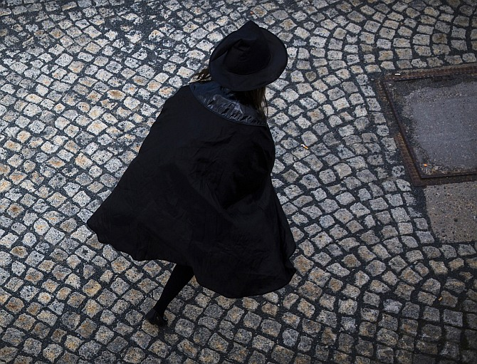 A woman dressed up as a witch walks at the summit of Brocken mountain in the Harz region celebrating the Walpurgisnacht pagan festival