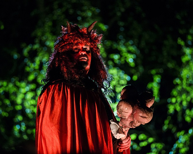 A man dressed as a devil is bathed in red light at a Walpurgisnacht pagan festival in the town of Stiege, in the Harz mountain region