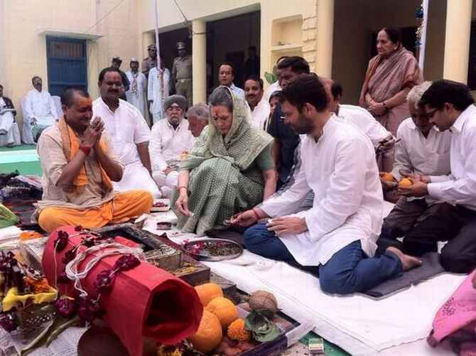 Sonia Gandhi and Rahul Gandhi, alongside Pandit Radheshyam, conduct a havan at the Congress office in Rae Bareli last month.