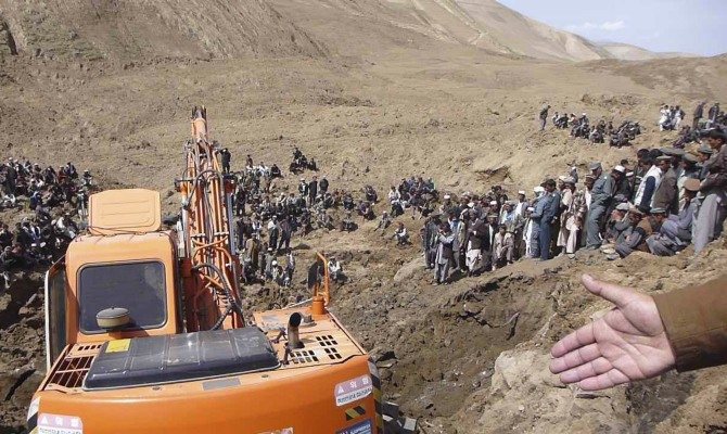 An excavator digs at the site of a landslide at the Argo district in Badakhshan province