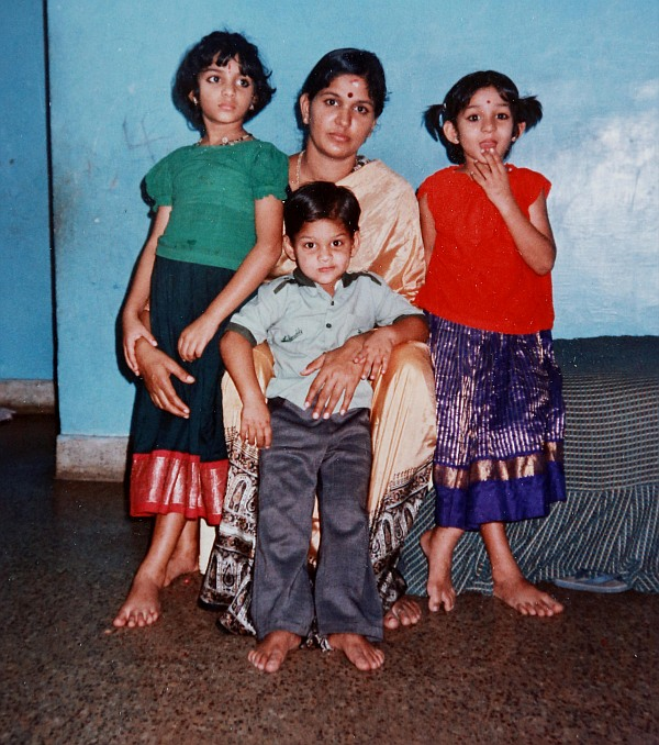 A childhood photograph of Major Mukund Varadarajan with his mother and sisters.
