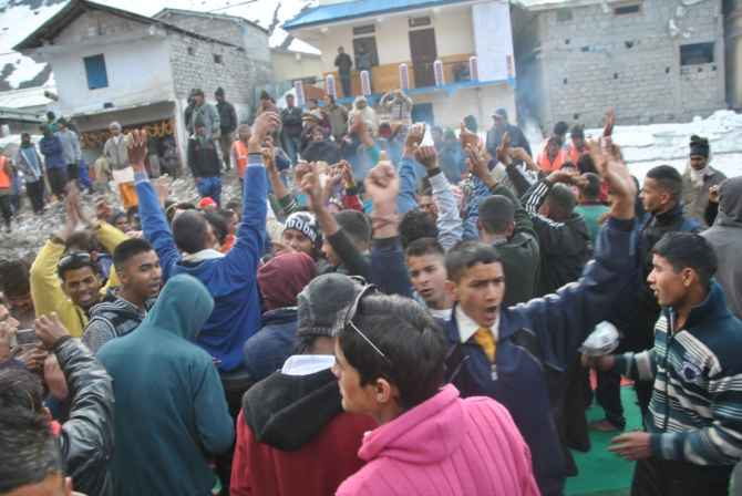 Devotees cheer at the Kedarnath temple on the first day of its reopening on Sunday