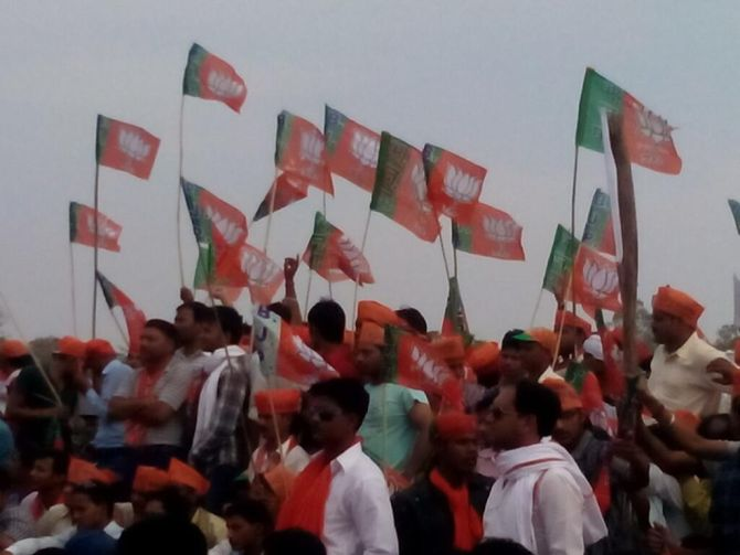 BJP supporters wave flags at Modi's rally in Amethi