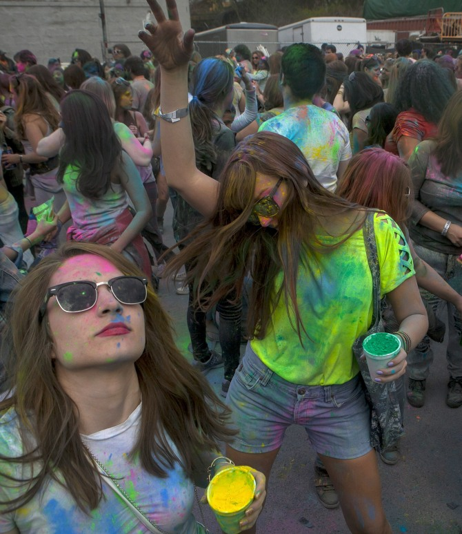 People celebrate Holi on May 3, 2014 in the Brooklyn borough of New York City