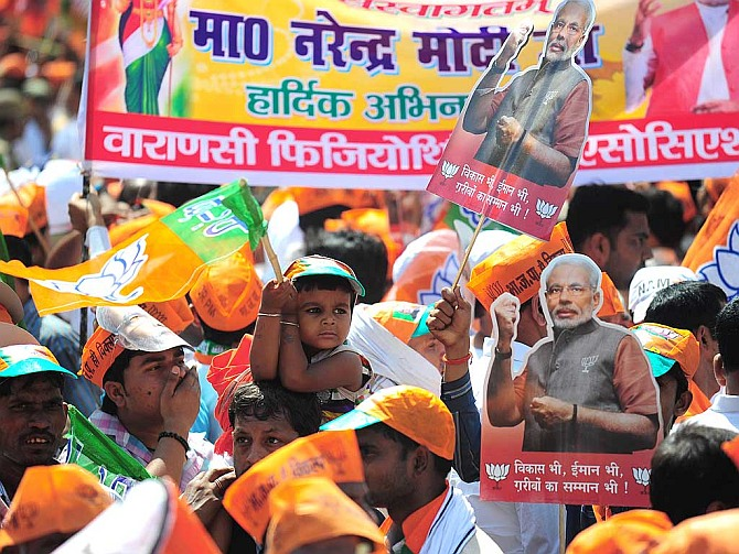 BJP supporters during the Modi road show in Varanasi. Photograph: PTI photo