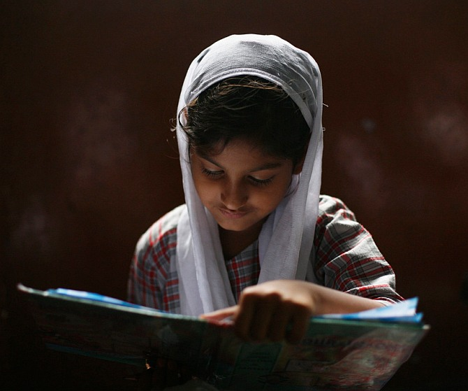 A Muslim girl at a madrassa in the old quarters of Delhi.