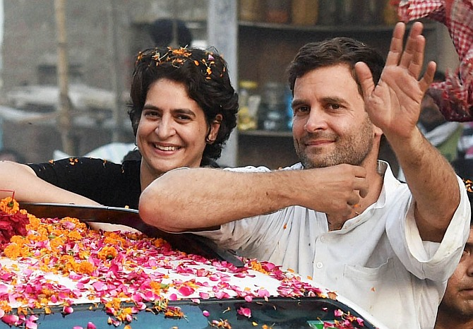 Priyanka Vadra and Rahul Gandhi at a roadshow in Amethi.