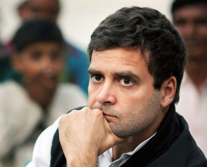 Rahul listens to a party worker speak in Amethi.
