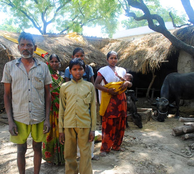 Savitridevi's family with the buffalo she bought with a loan of Rs 30,000 from the Santoshimata Swayam Sahayata Samuh.