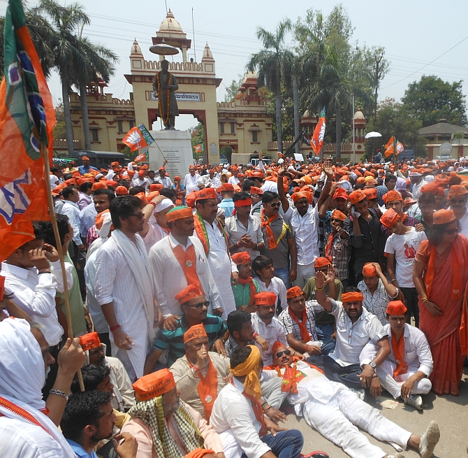 BJP workers shout slogans outside Banaras Hindu University