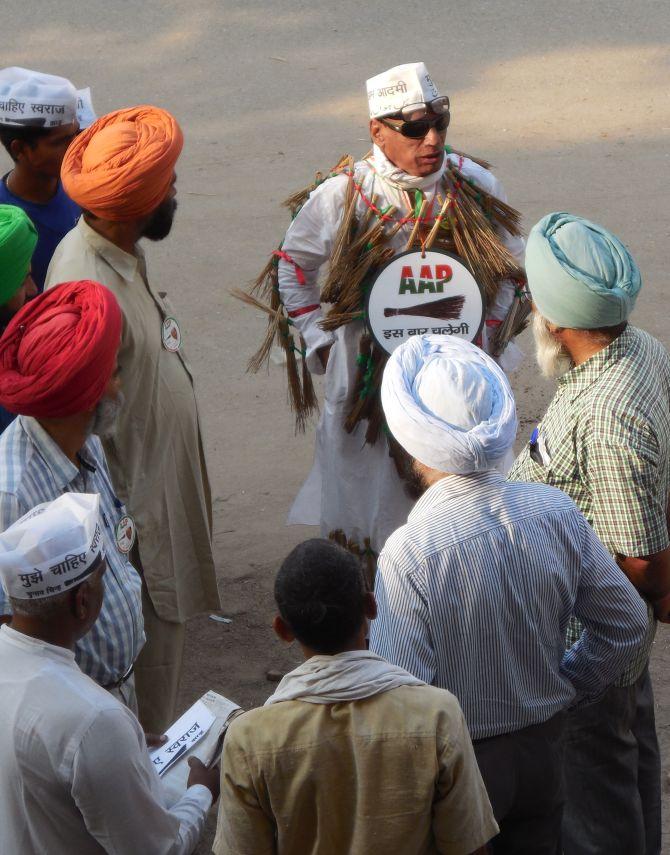 An Aam Aadmi Party volunteer shares his views with volunteers from Punjab outside AAP leader Arvind Kejriwal's home in Varanasi.