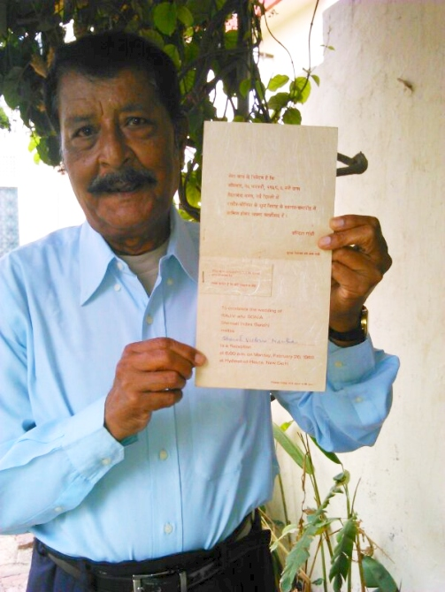 Basil Nathan poses with the wedding invitation that Indira Gandhi sent his mother Victoria in 1968.