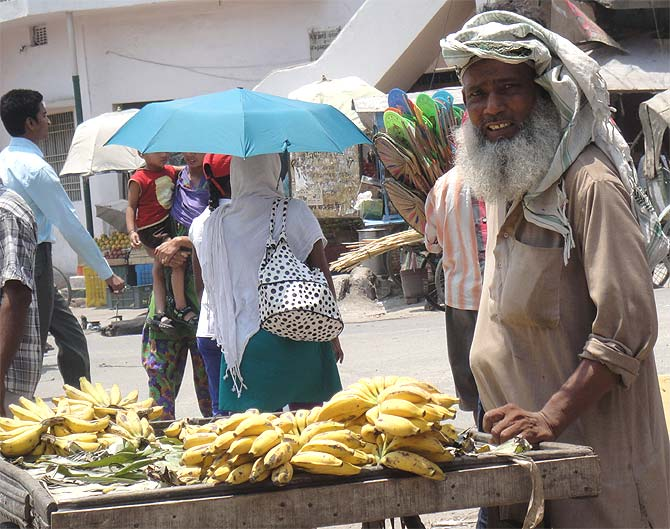 A man with a cart of bananas on a Sunday morning in Chhapra.