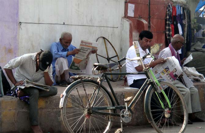 Locals read newspapers at Thana Chowk in Chhapra.