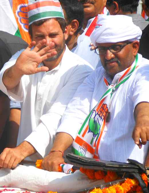 Rahul Gandhi and Congress candidate Ajai Rai wave to supporters during a roadshow in Varanasi on Saturday
