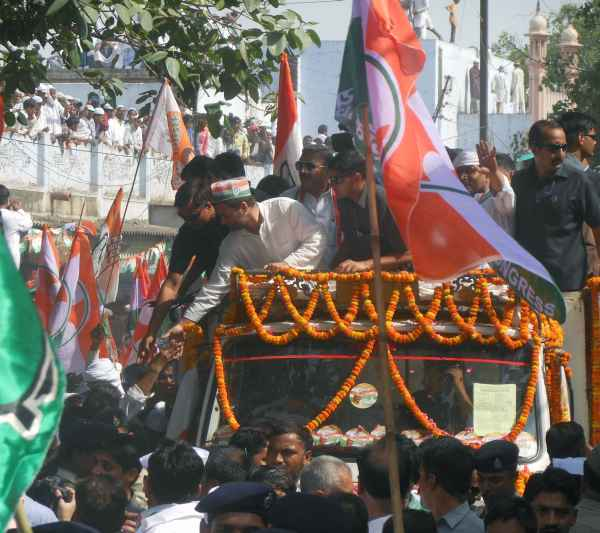 Rahul greets supporters during a roadshow in Varanasi on Saturday