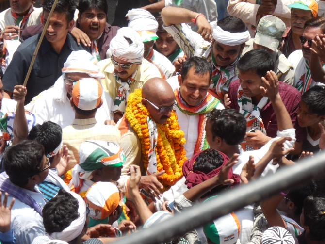 A lookalike of Congress candidate Ajai Rai is cheered by the crowd.