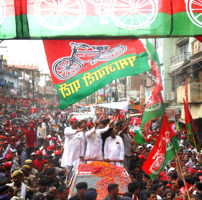 Uttar Pradesh Chief Minister Akhilesh Yadav campaigns with Samajwadi Party leaders in Varanasi.