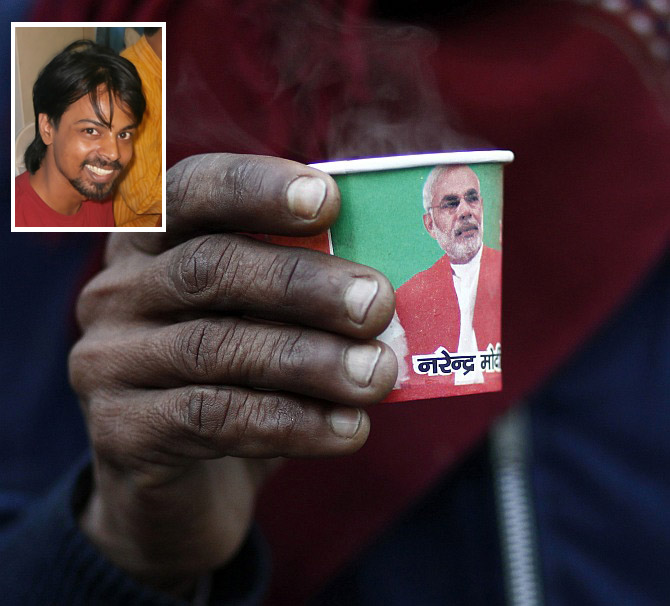 A man with a cup carrying a portrait of Narendra Modi. Inset: Vikas Pande.