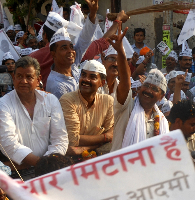 Arvind Kejriwal, right, during a roadshow in Varanasi.