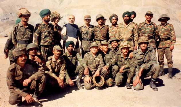 Narendra Modi with soldiers. Kind courtesy: narendramodi.in