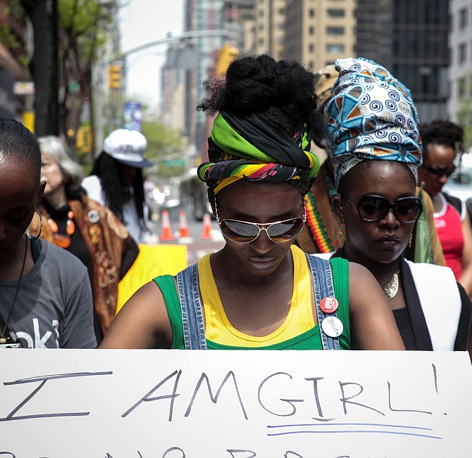 Activists pause during a prayer vigil for abducted Nigerian schoolgirls in front of the Consulate General of Nigeria in Manhattan, New York