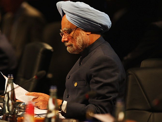 Dr Manmohan Singh during an executive session on the second day of the Commonwealth Heads of Government Meeting at the Hyatt Hotel in Port-of-Spain, Trinidad And Tobago