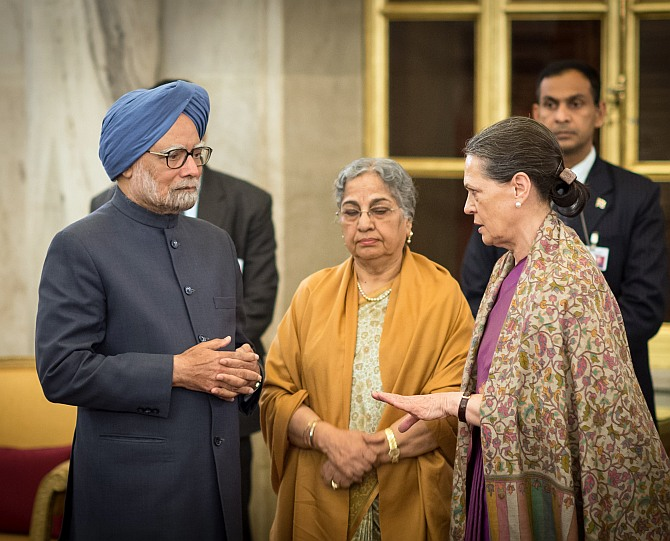 Prime Minister Manmohan Singh and his wife Gursharan Kaur with Congress President Sonia Gandhi