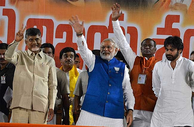 Chandrababu Naidu, Modi and Pawan Kalyan share a dais during a rally