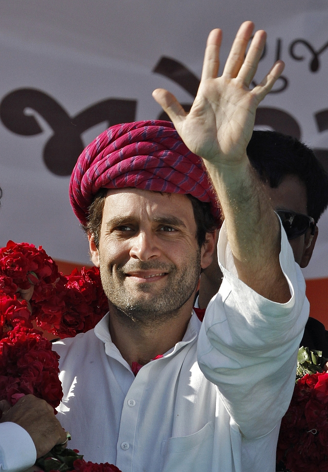 Rahul waves to his supporters in Sanad, Gujarat