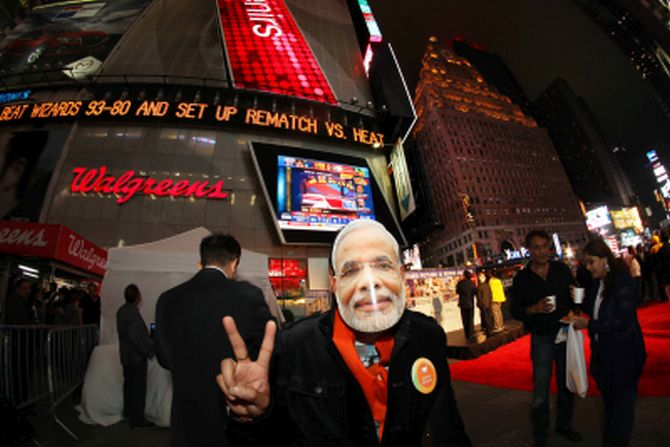 A BJP supporter wears a Modi mask at Times Square, New York