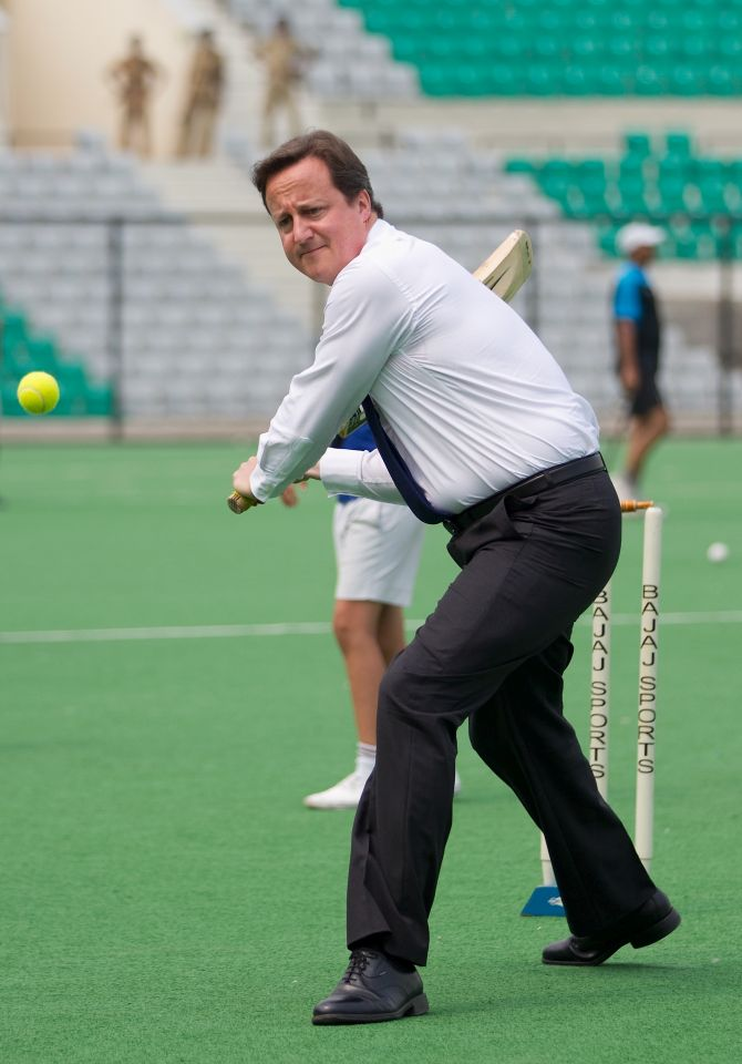 UK PM David Cameron plays cricket during his visit to the country in 2010.