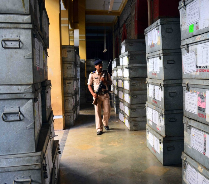 A policeman inspects sealed EVM machines at Elphinstone College in Mumbai