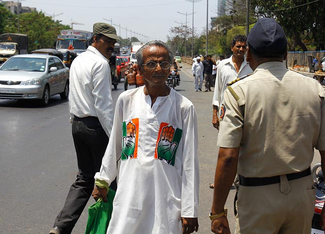 A stunned Congress supporter in Mumbai.