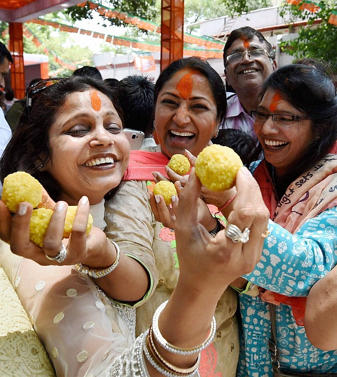BJP activists celebrate partys victory in Lok Sabha polls, at the partys Delhi Pradesh office in New Delhi on Friday.