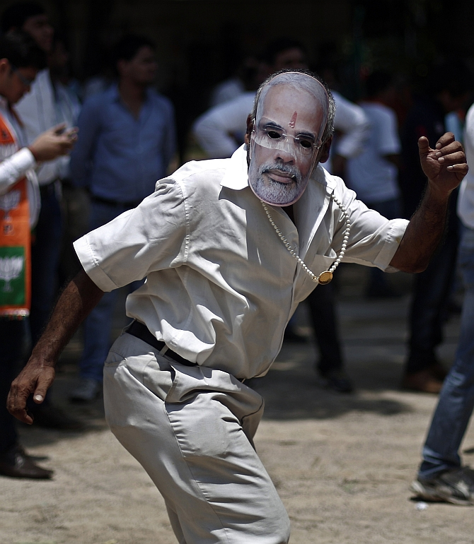 A Modi supporter celebrates in New Delhi