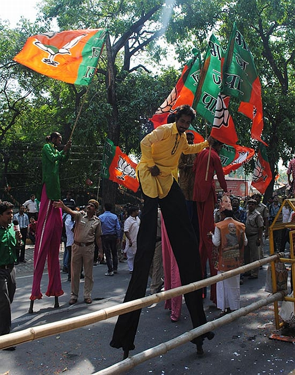BJP supporters celebrate outside the party HQs in New Delhi
